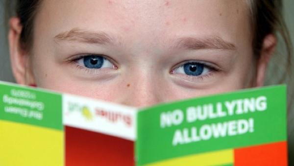 Boy holding a No Bullies Allowed book