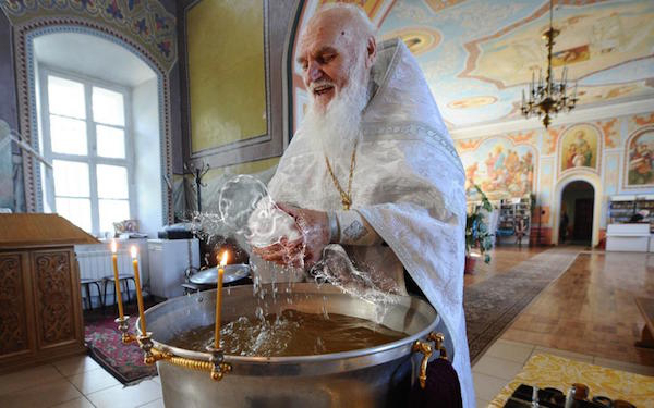 priest-baptizing-a-baby-gets-a-healthy-dose-of-photoshop-from-the-internet-24-photos-10