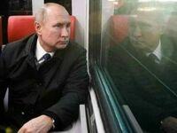 Putin patrzący na przyszłego prezydenta Rosji